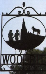 Ortsschild von Woolpit mit den grünen Kindern